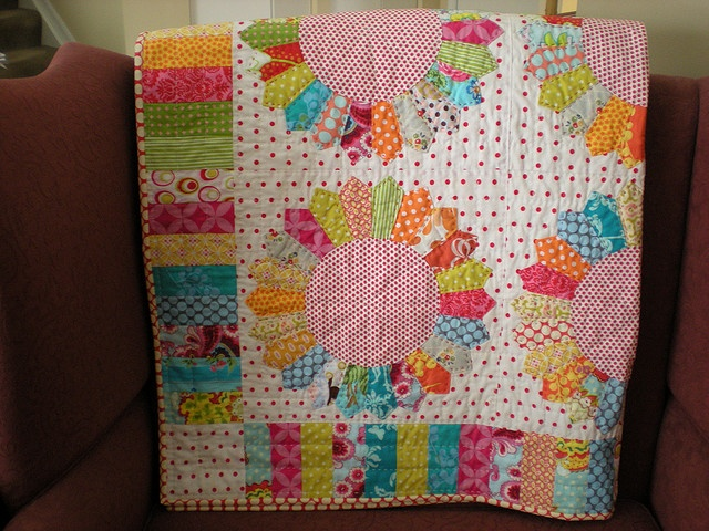 I LOVE THIS!  I am going to use all my girls scrap fabrics from their dresses and make one of these!