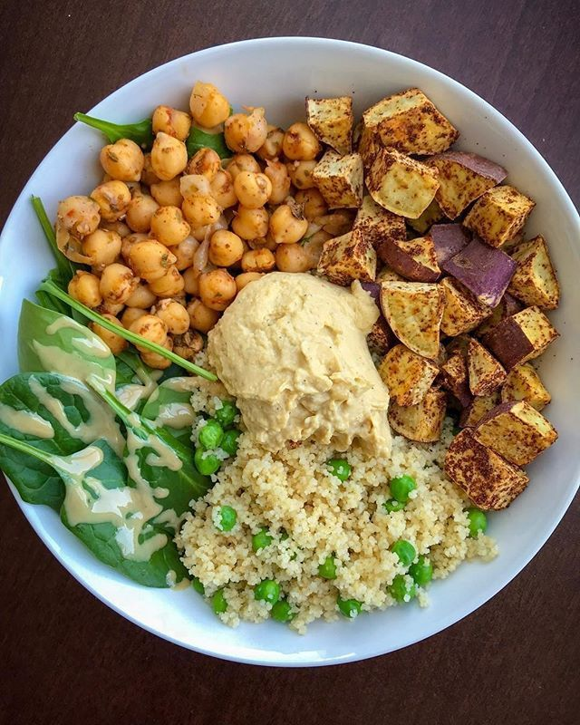 We love veggie power bowls!  Blend our #greensriracha into your hummus for an extra garlic kick! Check our bio to grab your #srirachagranada today! . Courtesy of @beazysbitesmade spiced japanese sweet potatoes (paprika cinnamon chili flakes cumin & salt)  chickpeas cooked in a pan w/ some garlic paprika & @frontiercoop pizza seasoning  whole wheat cous cous  green peas  spinach w/ some lemon tahini  @hopefoods original hummus . . #srirachaoneverything #srirachalover #srirachasauce…