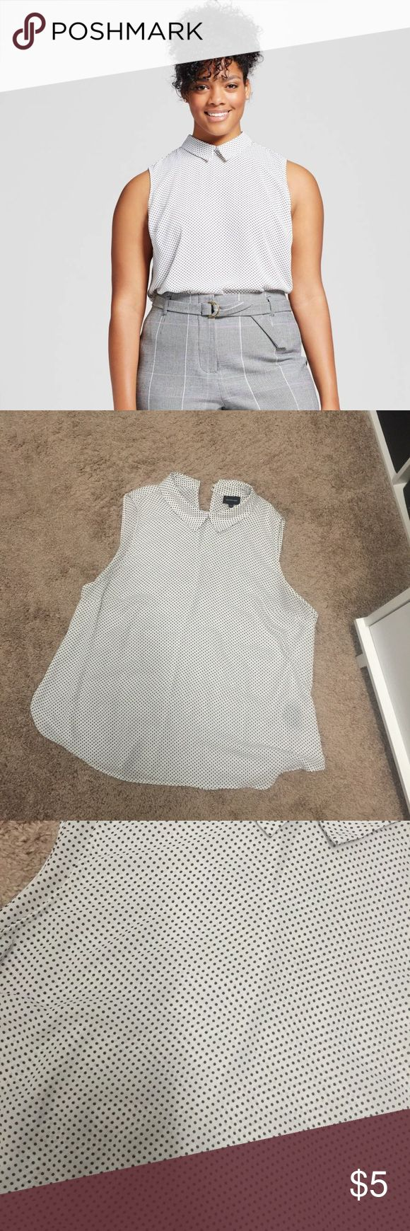 What to wear collared polka dot shirt Excellent used condition. From target. I don't have any problem wearing a nude bra under this but if you're in bright light I'd recommend a cami under. Dots are black/blue depending on the light. Think they are supposed to be black but sometimes they look blue to me Tops Blouses