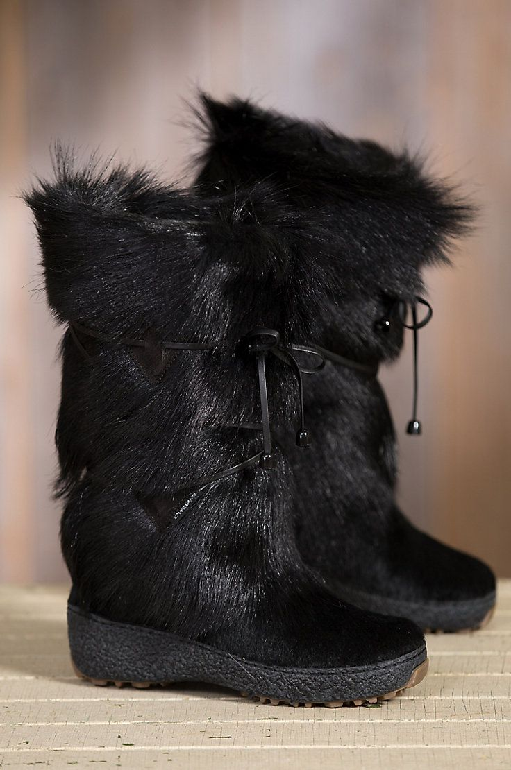 Handcrafted in a premium goat fur shaft, this feminine boot features a soft, smooth, calfskin hair-on leather shoe. Made in  Italy.