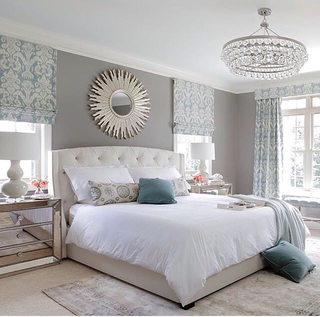 White tufted head board with mirrored side tables