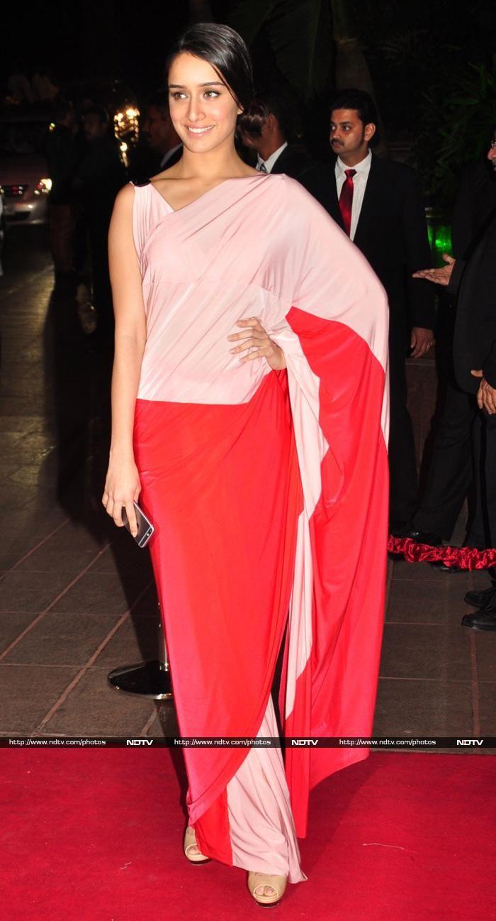 Shraddha Kapoor was wearing a Shivan and Narresh sari at Arpita Khan's Wedding Reception. Interesting sari #colorblocking