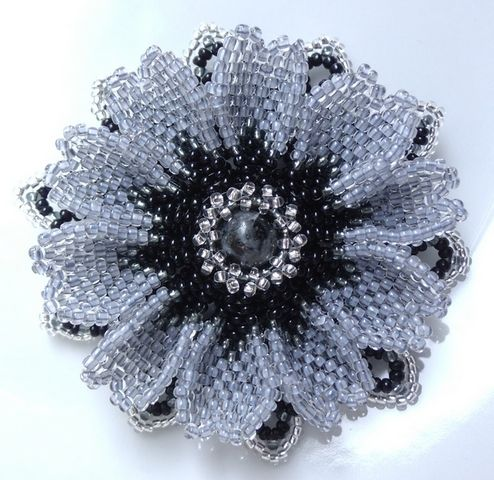 beaded flower (bead/pearl center)