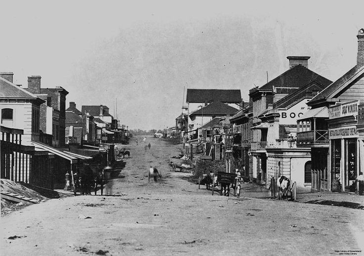Early view of Queen Street, Brisbane, Queensland, ca. 1864 - People, horses and carriages on unsealed Queen Street in Brisbane, Queensland, around 1864. Timber, stone and brick shops and buildings line either side of the street.