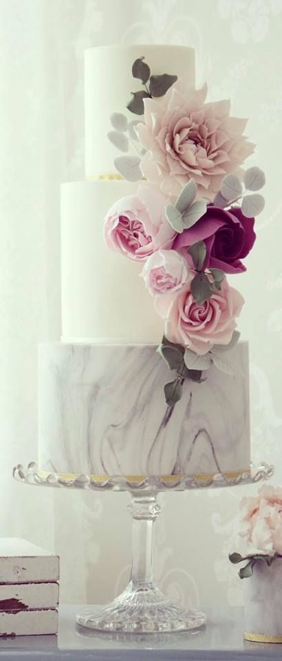 Taking a cue from geology, marble wedding cakes are definitely having a moment in the cake world. By Cotton & Crumbs.