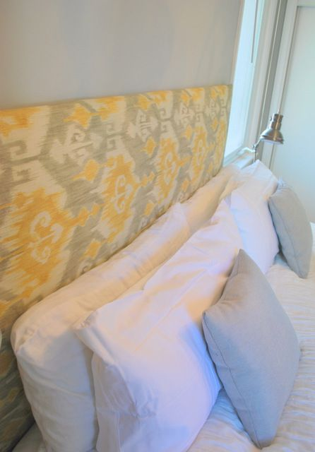 DIY Headboard for under $100, she just used extra thick batting (no foam) and then stapled it on, covered with fabric and hung it with a french cleat