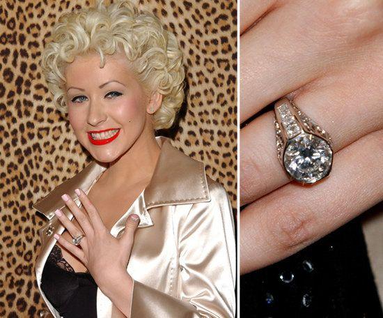 Christina Aguilera's original engagement ring from Jordan Bratman featured a five carat diamond set in yellow gold with lots of diamond detail.