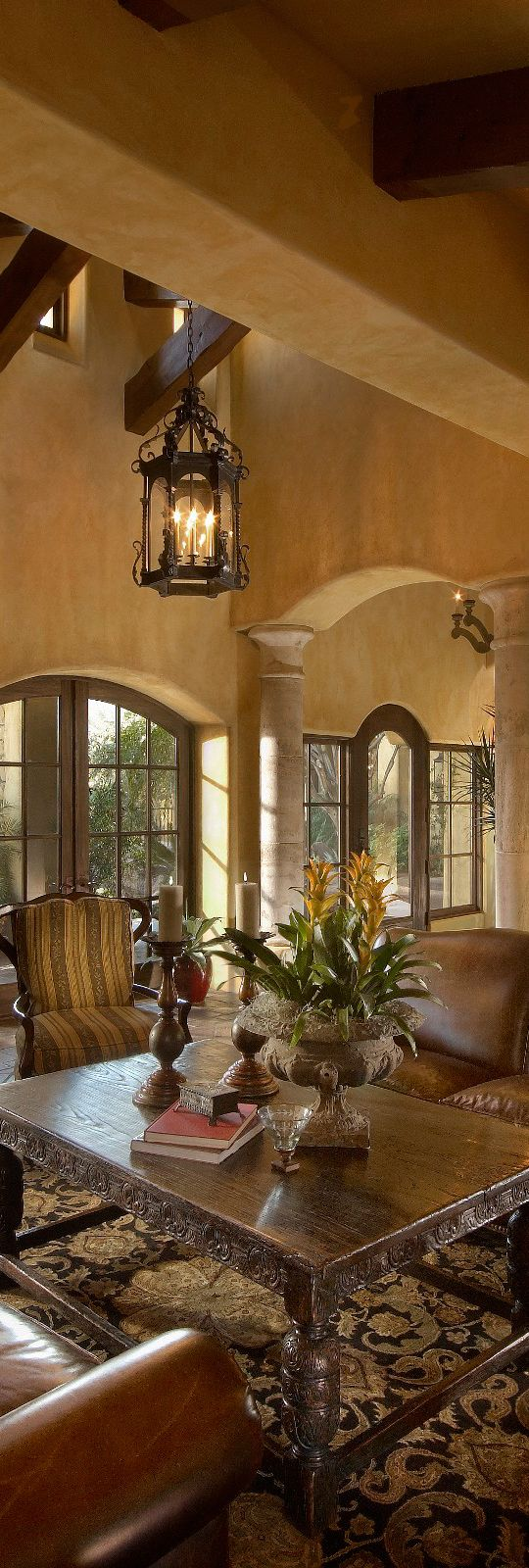 Cozy sitting area. Love all the arched windows. Mediterranean | Tuscany | Old World Style