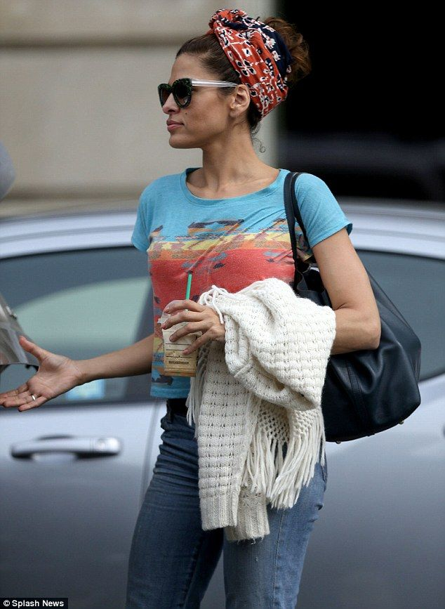 Festive wrap: The 39-year-old star was dressed down more than usual and hid her luxurious brown hair in a red bandana