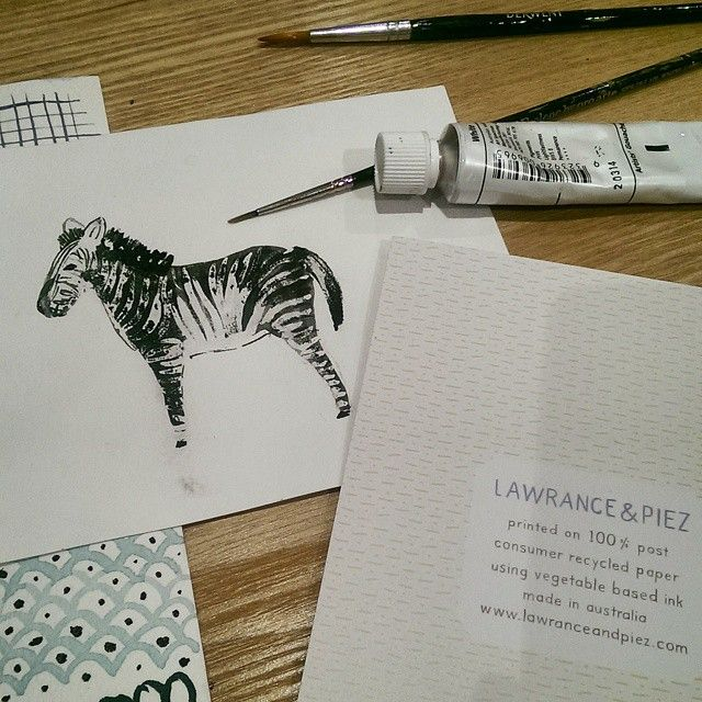 Painting characters and patterns for birthday cards. We washed the paper under water to get the texture on the zebra.