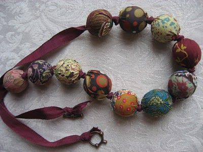 fabric bead necklace.. Neat! The part of me that used to wear homemade hemp and beaded jewelry wants this piece ;)