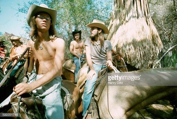Gerry Beckley Dewey Bunnel and Dan Peek of folkrock trio America ride horses America is best remembered for the anthemic 'A Horse with no Name'