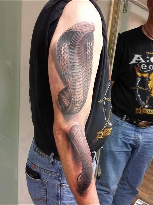 The Most Disturbing #Tattoos Ever. This guy not only has a cobra on his bicep, but it is popping out from his forearm. Either that or he has an easily accessible handle bar.
