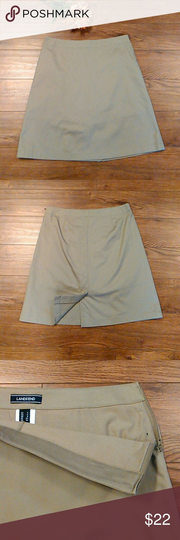 """NWOT Land End Tan Chino Skort Size 4 NWOT Land End Tan Chino Skort Size 4  Kick Vent in Back Side Zipper No Pockets  60% Cotton 40% Polyester  Aprox Measurements Taken Flat  Waist: 15.5""""(31) Length:20""""  In Pre-Owned Condition With No Stains Or Holes.  Smoke and Pet Free Home  Please Check Out My Other Items  #216 Lands' End Shorts Skorts"""