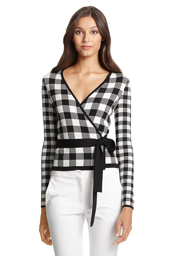 The DVF Kyla is a ballerina wrap style in the season's gingham print. With contrast edges and self-tie belt. Fit is true to size.