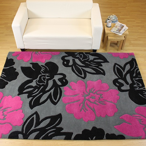 Matrix - a thoroughly contemporary design in bold colourways gives this nature-inspired rug high impact with its stylised, floaty florals in full bloom. Handtufted with a heavyweight, 100% wool pile, this grey, pink and black rug has an irresistibly dense and soft texture. Also easy care and very durable. From £74.95