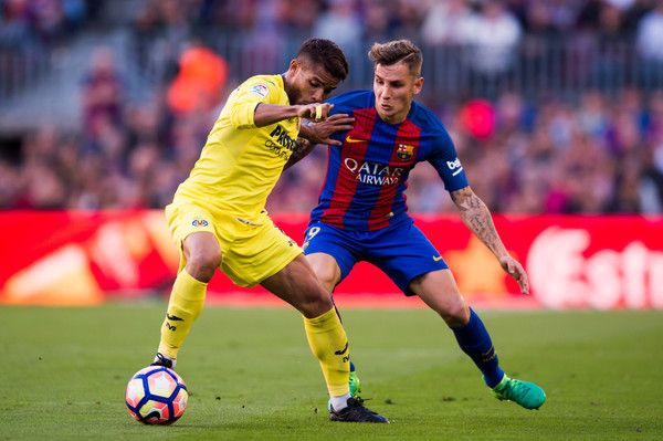 Jonathan dos Santos (L) of Villarreal CF competes for the ball with Lucas Digne (L) of FC Barcelona during the La Liga match between FC Barcelona and Villarreal CF at Camp Nou stadium on May 6, 2017 in Barcelona, Catalonia.