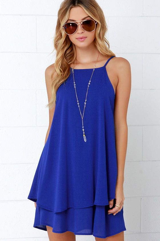 Let yourself be fun and fancy-free in the Dee Elle Whimsical Whim Royal Blue Dress! A high, squared-off neckline connects to spaghetti straps that frame a V back with horizontal strap, all made from woven rayon. Loose-cut bodice flows into a flirty, tiered bottom hem. Unlined. 100% Rayon. Hand Wash Cold.