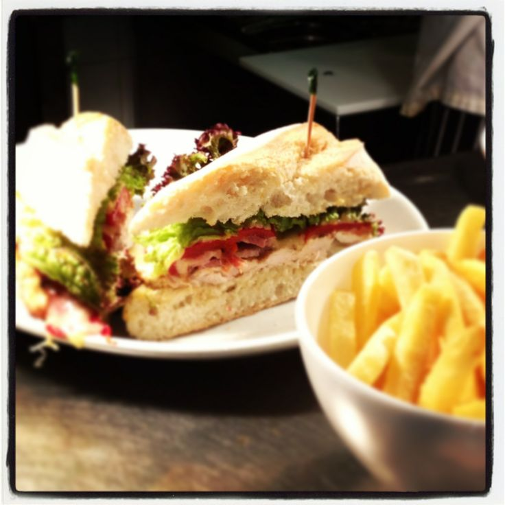 Calypso Chicken Sandwich A tender char-grilled Cajun chicken breast with bacon, cheddar cheese, roasted red peppers, lettuce and a zesty lime & red ginger mayonnaise. Served in toasted rustic bread with fries.  www.therainforestcafe.co.uk