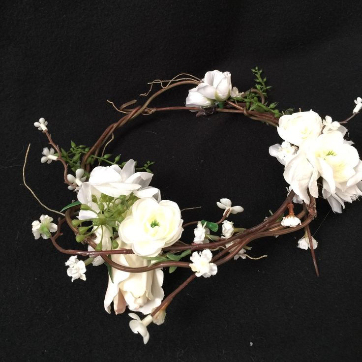 Just made this as a custom floral vine crown for a special little girl. Decided to add it to my line. It's so pretty in person. Only wish I had a model to picture it on.