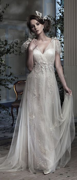 Tulle gown over satin with lace applique and beaded decoration by Ian Stuart