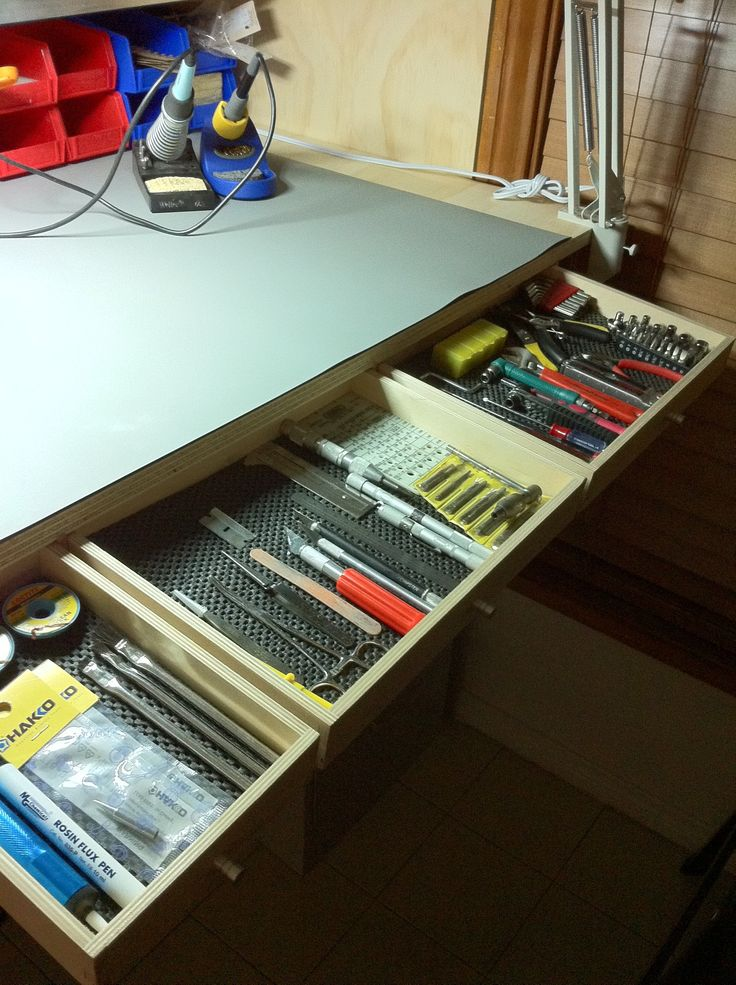 Closeup of electronic workbench custom drawers.  They came from a few old Ikea rolling cupboards (shown upside down and mounted to the wall above the workbench).  Simply cobbled together a shell to hold each drawer in place under the bench.  I plan on adding a 2nd layer of drawers under those soon.