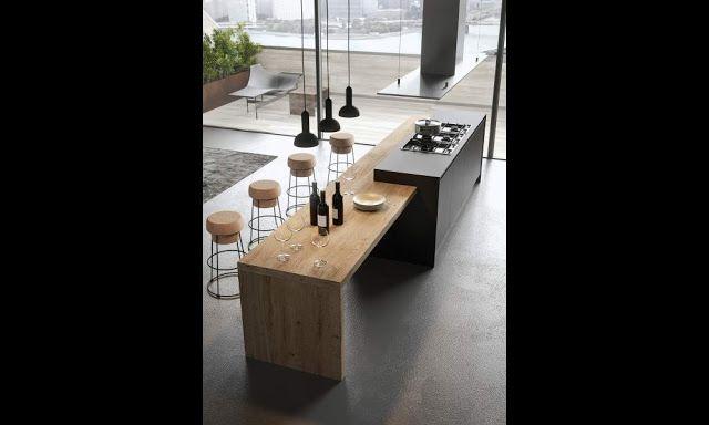 Grand îlot de cuisine moderne gris anthracite avec un superbe espace repas en bois. http://inspiration-cuisine-design.blogspot.fr/2016/01/cuisine-moderne-gris-anthracite-et-bois.html