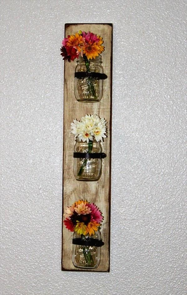 Pallet Mason Jars Hanging Wall - I would use candles instead of flowers :)