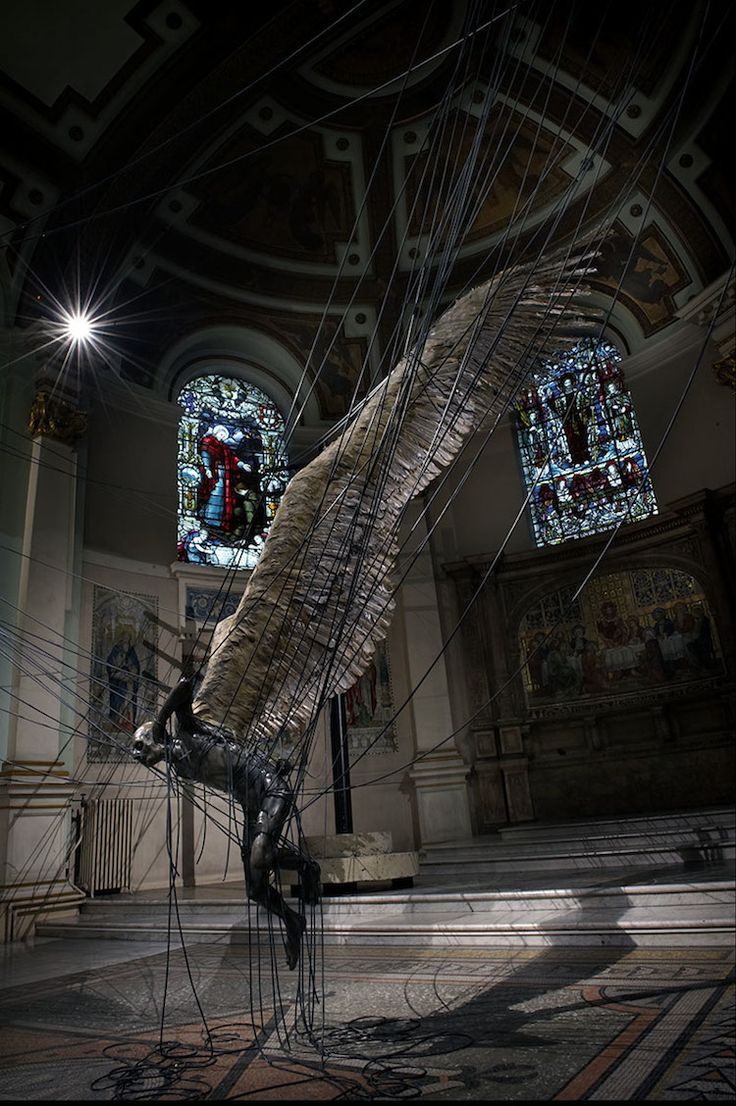 'Morning Star' by Paul Fryer. The Holy Trinity Church in Marlebone, Westminster, built specifically to celebrate the defeat of Napoleon, but hasn't been used as a place of worship since the 30s. The Lucifer body is made of wax, the wings are real feathers, and the figure is caught in telephone wires.