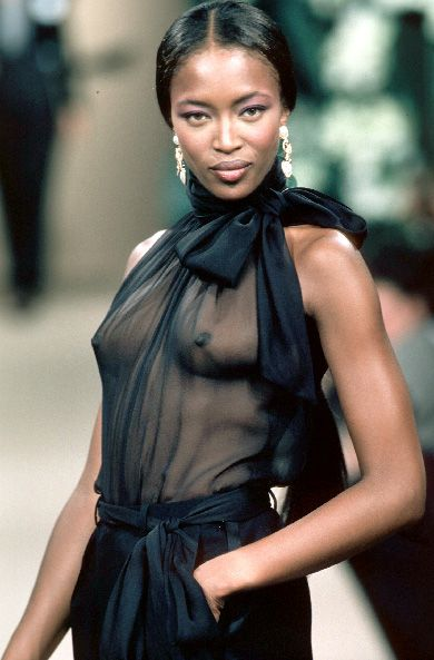 Naomi Campbell at Yves Saint Laurent Haute Couture SS 1991, designers began to show sheer garments with little or no underwear, creating a scandal.