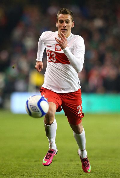 Arkadiusz Milik Photos - Arkadiusz Milik of Poland during the International Friendly match between Republic of Ireland and Poland at Aviva Stadium on February 6, 2013 in Dublin, Ireland. - Republic of Ireland v Poland - International Friendly