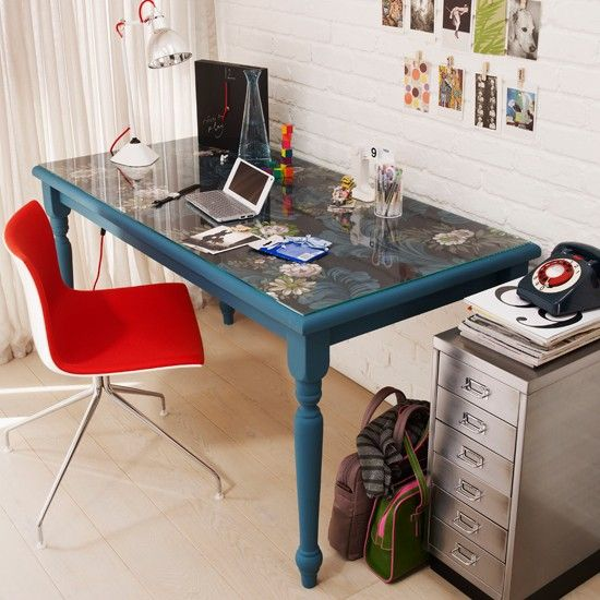Painted blue desk  If you'd prefer not to focus on your walls to add a splash of colour, why not turn your furniture into a feature instead? Try upcycling a desk with bold coloured paint, like this teal pine desk finished with patterned wallpaper and a glass top