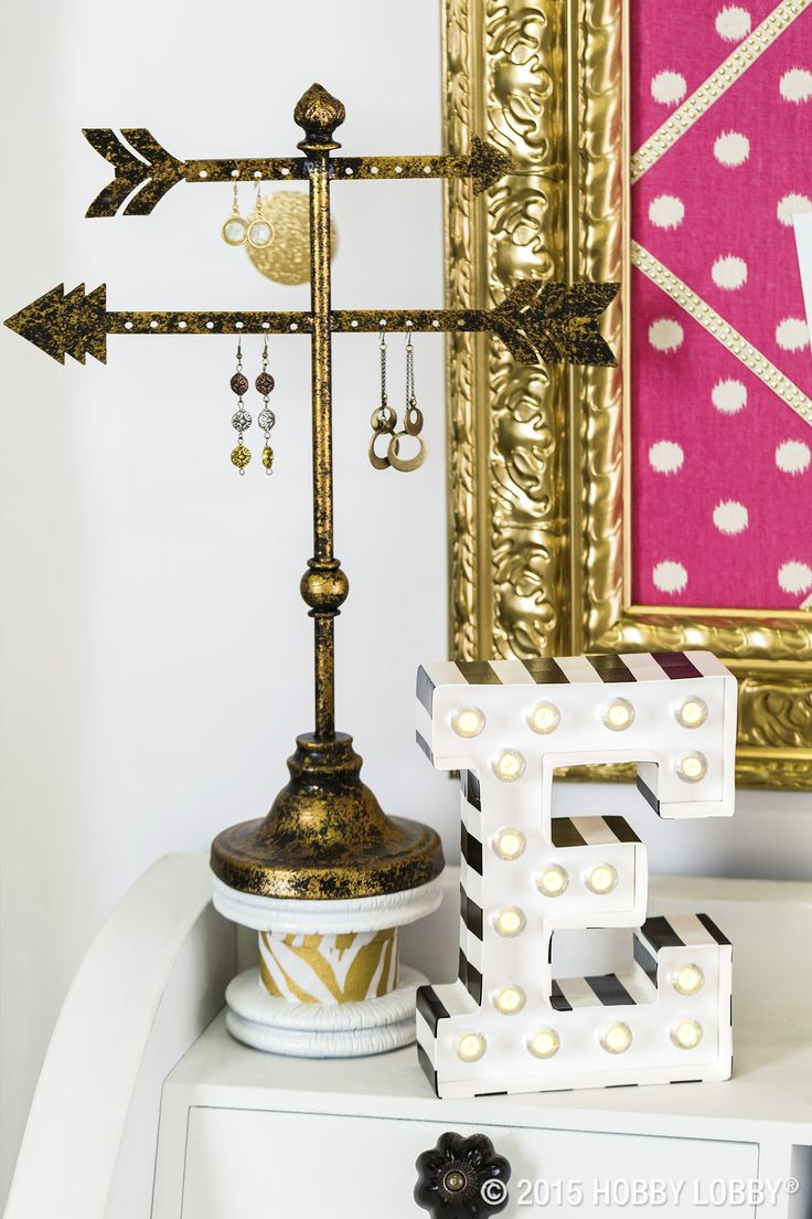 Hollywood glam is at your fingertips with this chic, gold and black dresser decor.