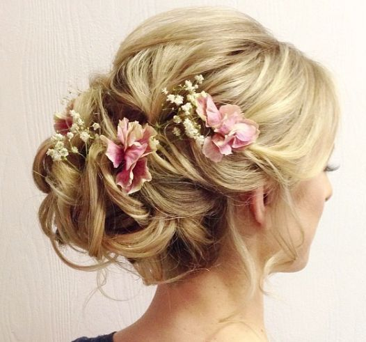 Stunning updo wedding hairstyle with pink flower hair accessories; Featured Hairstyle: Heidi Marie Garrett