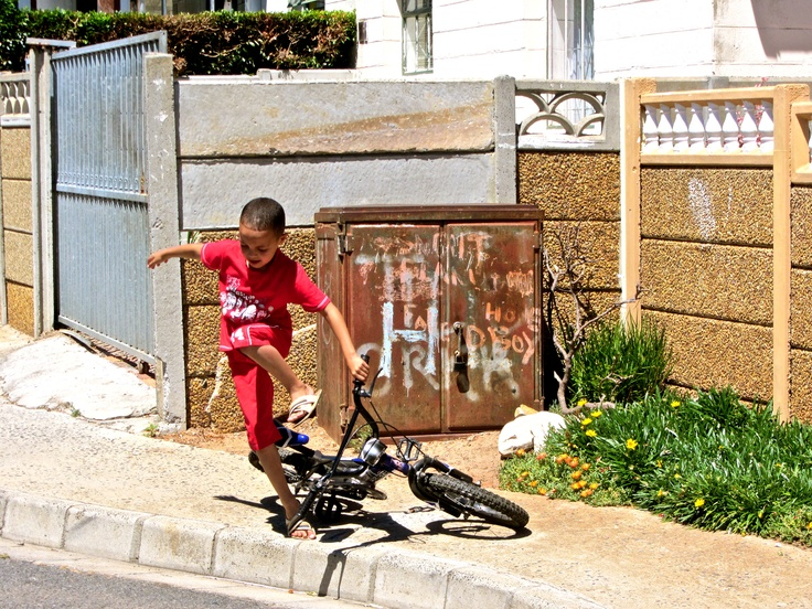 Child at play on a sunday afternoon. Oceanview Township, Cape Town, South Africa.