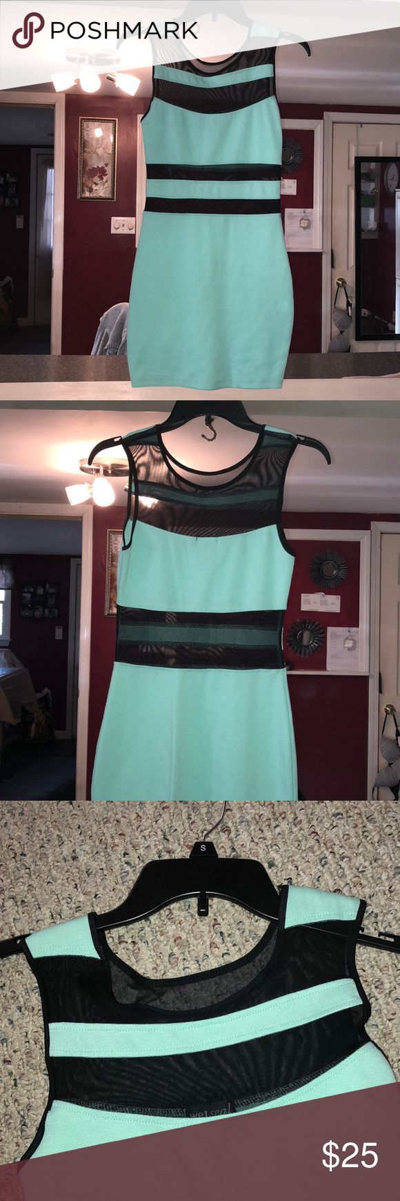 Night out dress Fun dress for a night out, definitely different! Mint green with black mesh at the top and stomach area. Worn once, loved it! Wet Seal Dresses Mini