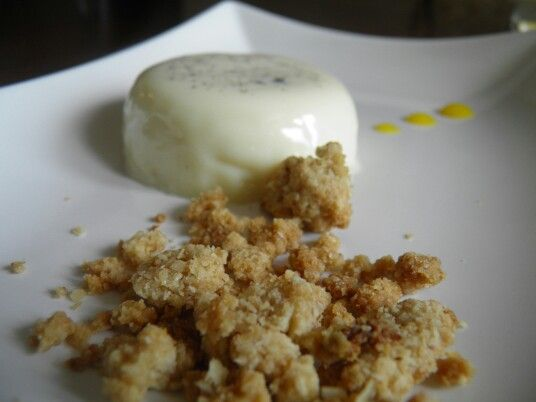 White chocolate panna cotta with coconut crumble and mango coulis