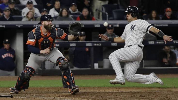 October 17, 2017:  Yanks beat Astros 6-4 to even ALCS at 2.  New York Yankees' Gary Sanchez is forced out at home as Houston Astros catcher Brian McCann takes the throw during the eighth inning of Game 4 of baseball's American League Championship Series Tuesday, Oct. 17, 2017, in New York. (AP Photo/David J. Phillip) David J. Phillip