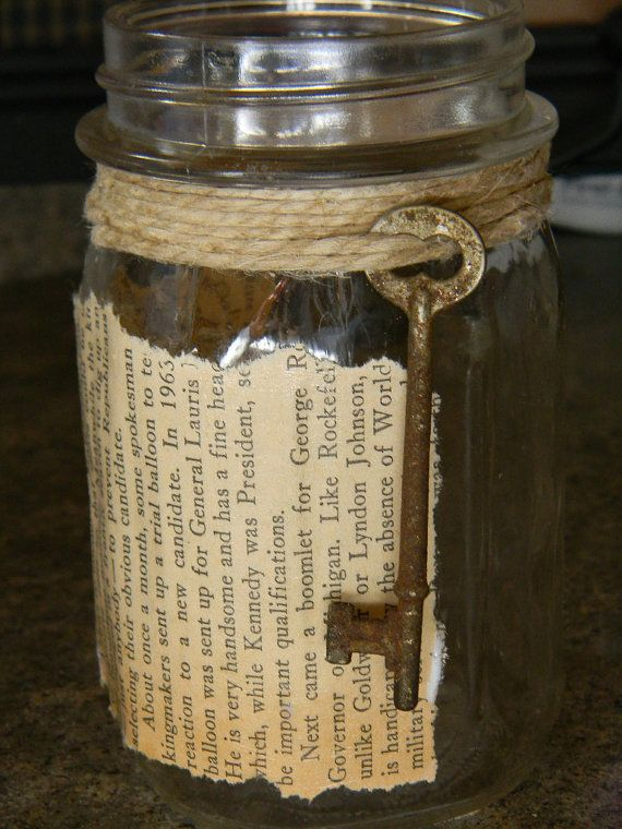 Mason jar decorated with book page and an old key. Could be a pencil holder, put a candle in it, or just for decoration. Love!