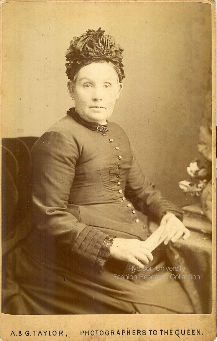 Woman sitting. Photographed by A. & G. Taylor. Location is somewhere in the United Kingdom (see stamp). FRC 2002.04.226