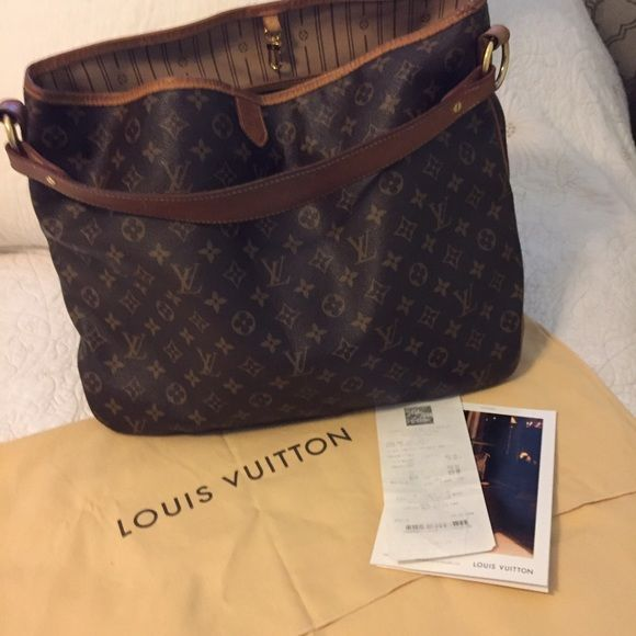 Authentic Louis Vuitton Monogram Delightful MG The perfect shopping bag. No scratches or damages outside. Little steins inside,serial number(code date) and dust bag . Louis Vuitton Bags Shoulder Bags