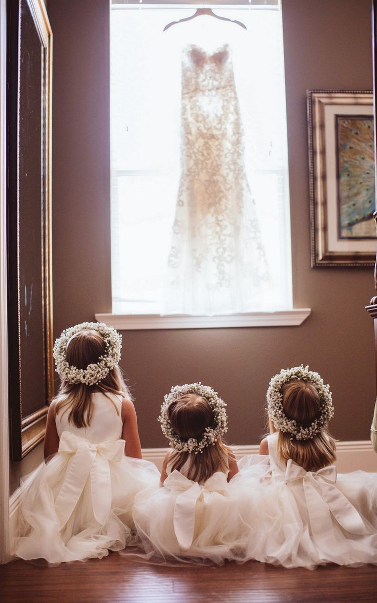Little Flower Girls -dreaming of the day when it will be their wedding dress hanging there.