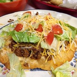 Easy-to-make fry bread needs just two ingredients, self-rising flour and buttermilk. Top the golden brown fried breads with a spicy ground beef and bean mixture, then garnish with your favorite taco trimmings.