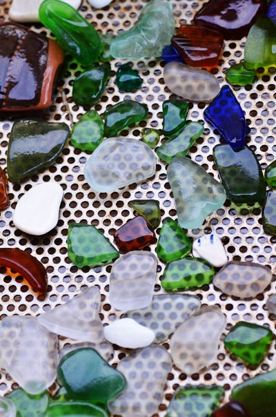 Sea Glass Rocks • Lake Erie Sea Glass: Today's Catch  Filed Under Lake Erie on September 12, 2011  We went sea glassing at our favourite beach near Colchester, Ontario on the weekend. It was raining for several days – and I think this helped to bring in some great glass. Not a huge amount – but really nice quality! Found a gorgeous little turquoise piece (top photo, near the top, in the middle) and my daughter found an interesting aqua piece. Also found a piece of Blue Willow pottery.