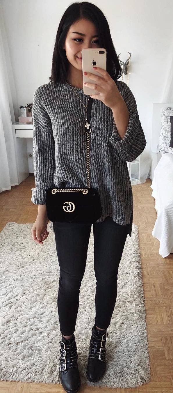 cozy winter outfit grey sweater velvet bag skinnies boots