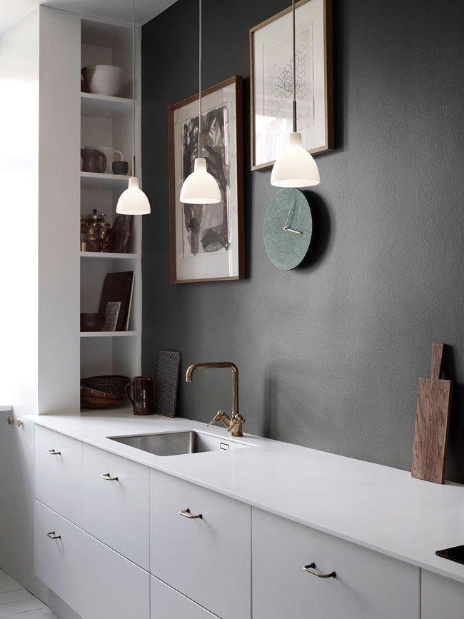 pinned by barefootblogin.com Lene Rønfeldt for Louis Poulsen Magazine - NordicDesign no cabinets on top, dark wall
