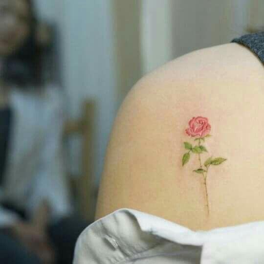 Pink rose tattoo