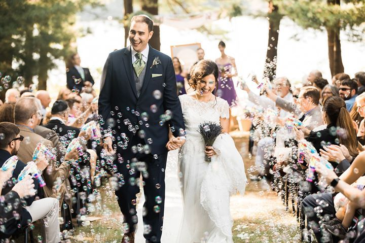 A spontaneous bubble recessional for the adorable Michael & Kate after their touching interfaith lakeside wedding near Lake Delton Wisconsin.   www.james-stokes.com