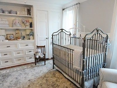Iron crib in pewter, paint color is 2 coats of dolphin by Martha Stewart. Bedding is from Pottery Barn Kids, Pique nursery bedding in light blue