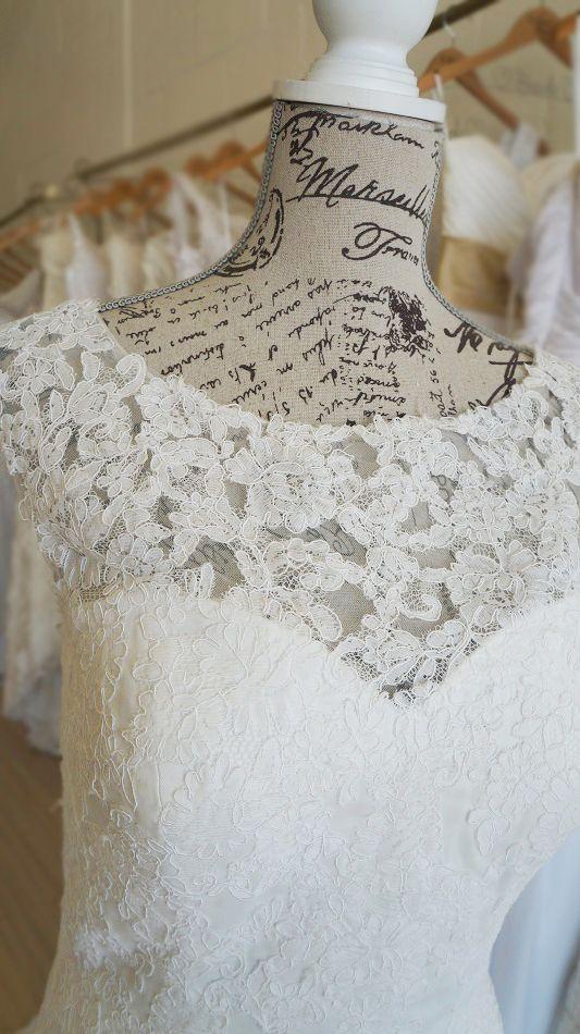 Vintage boat neck ivory lace wedding dress withan elegant keyhole styled back. Urban Bride Cape Town.